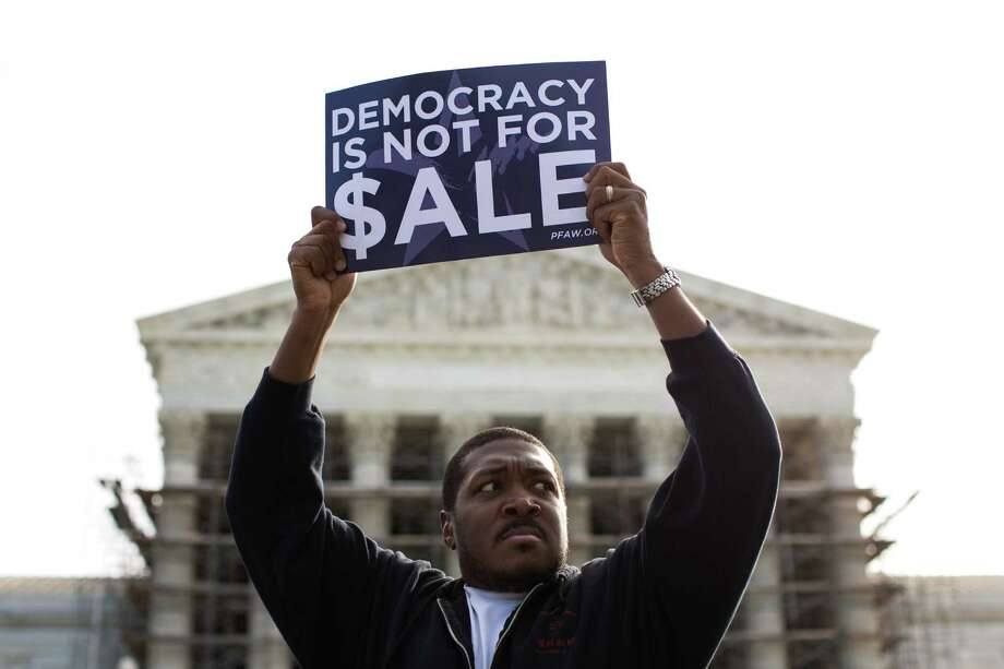 Cornell Woolridge rallies against money in politics outside the Supreme Court last October when the court began hearing oral arguments in McCutcheon v. Federal Election Committee. Photo: Drew Angerer / Getty Images / 2013  Getty Images