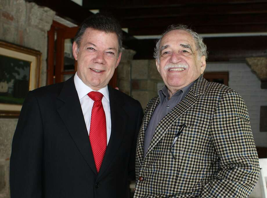 Handout picture released by the press service of Colombian elected President Juan Manuel Santos (L) as he poses with Colombian Literature Nobel Prize laureate Gabriel Garcia Marquez, in Mexico City on July 22, 2010. Colombia's Nobel-winning novelist Gabriel Garcia Marquez died on April 17, 2014 in Mexico City at the age of 87, Mexican and Colombian media reported. Photo: Antonio Nava, AFP/Getty Images