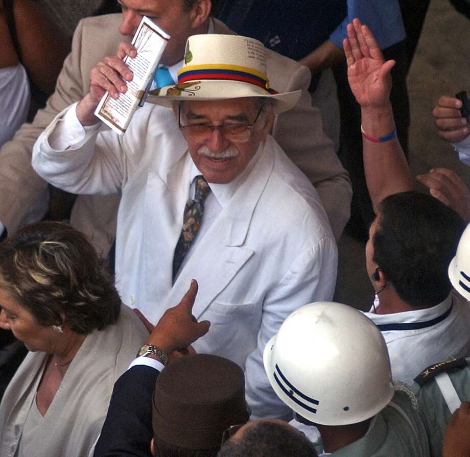 "Colombian writer and Nobel Prize Gabriel Garcia Marquez waves to fans, after the inauguration of IV International Congress of the Spanish Language, in Cartagena, Colombia, 26 March 2007. Colombia's Nobel-winning novelist Gabriel Garcia Marquez died on April 17, 2014 in Mexico City at the age of 87, Mexican and Colombian media reported. Garcia Marquez, the author of ""One Hundred Years of Solitude,"" passed away at his home with his wife and two sons by his side, Mexico's Televisa anchor Joaquin Lopez-Doriga said on Twitter, echoing reports in Mexican and Colombian newspapers. Photo: Str, AFP/Getty Images"