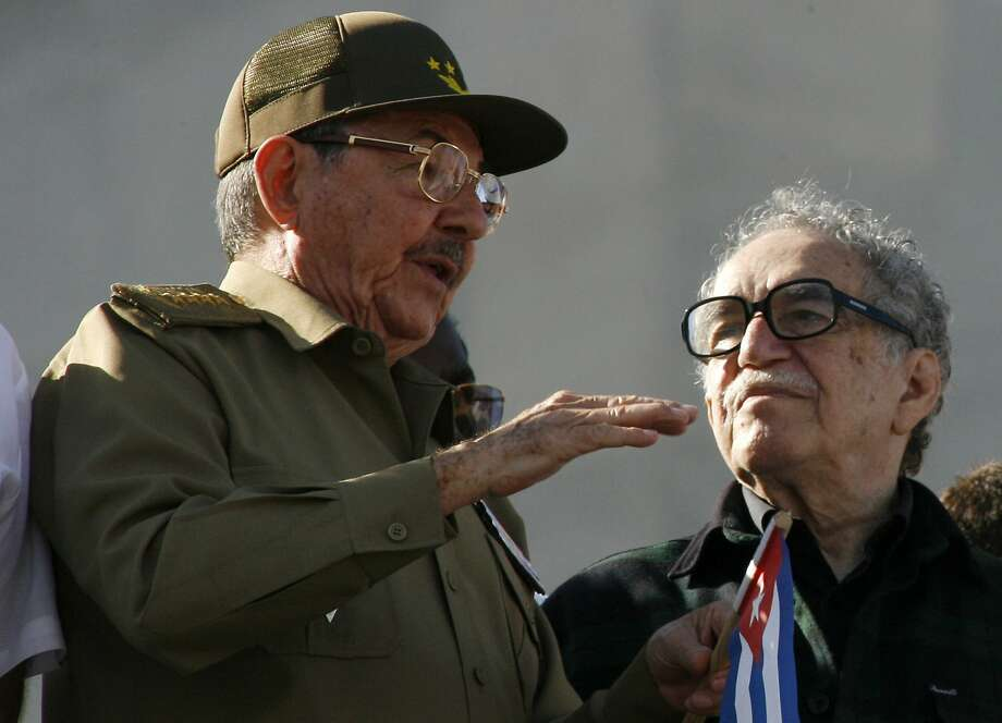 In this Dec. 2, 2006 file photo, Cuba's acting President Raul Castro, brother of Cuban leader Fidel Castro, left, chats with Colombian Nobel laureate Gabriel Garcia Marquez during a military parade in Havana, Cuba. Marquez died on Thursday, April 17, 2014 at his home in Mexico City. Photo: Javier Galeano, Associated Press