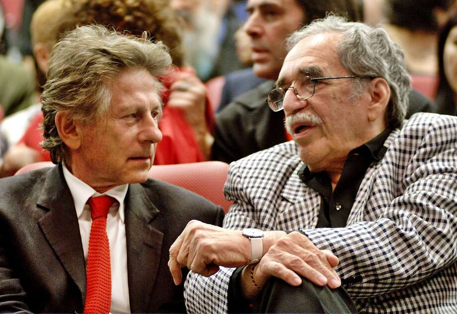 In this Dec.13, 2002 file photo, film director Roman Polanski, left, and Colombian Nobel laureate Gabriel Garcia Marquez speak during the closing ceremony of the Cuban International Film Festival  in Havana, Cuba. Marquez died Thursday April 17, 2014 at his home in Mexico City.  Photo: Str, Associated Press