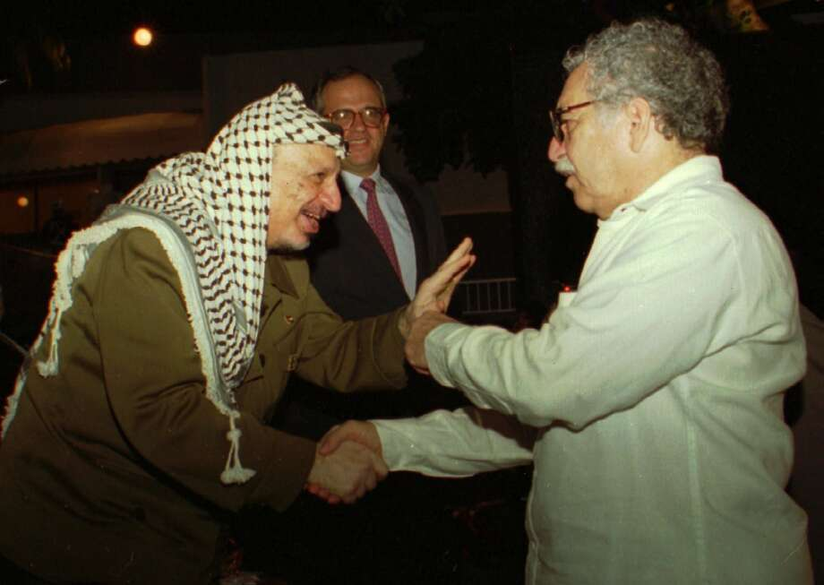 In this Oct. 20,1995 file photo, PLO Leader Yasser Arafat greets Nobel laureate Colombian Nobel laureate Gabriel Garcia Marquez during the closing ceremonies of the Non-Aligned Summit in Cartagena, Colombia.  In the background is Colombian President Ernesto Samper. Marquez died Thursday April 17, 2014 at his home in Mexico City.  Photo: Roger Richards, Associated Press