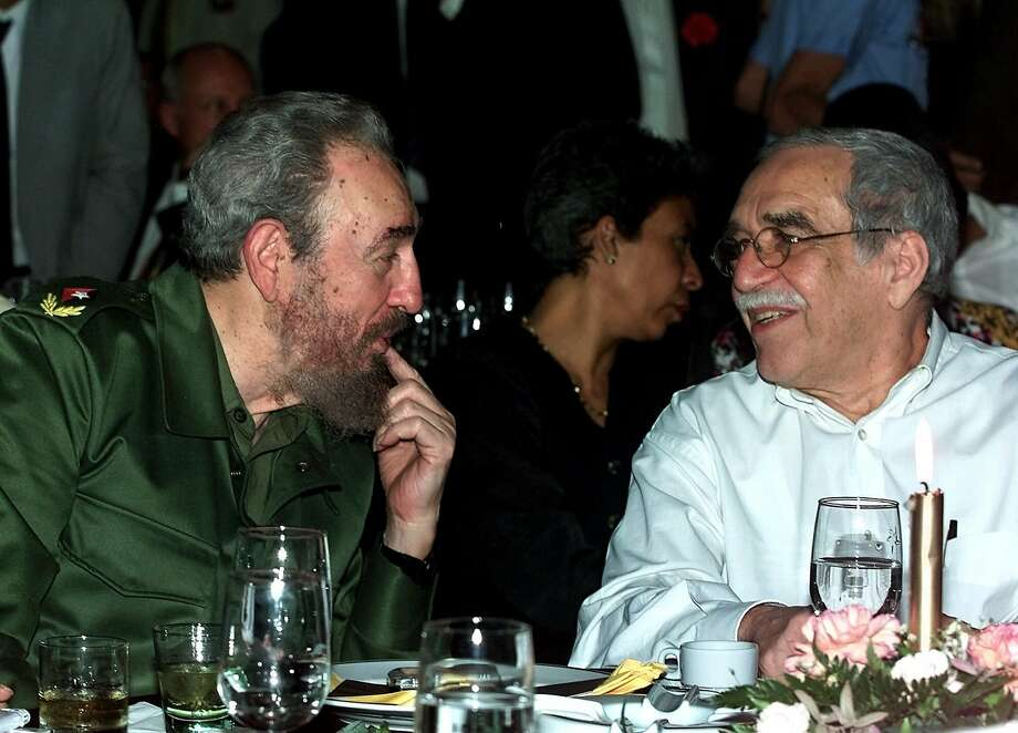 In this March 3, 2000 file photo, Cuba's leader Fidel Castro, left, and Colombian Nobel laureate Gabriel Garcia Marquez speak during a dinner at the annual cigar festival in Havana, Cuba. Marquez died on Thursday, April 17, 2014 at his home in Mexico City. Photo: Jose Goitia, Associated Press
