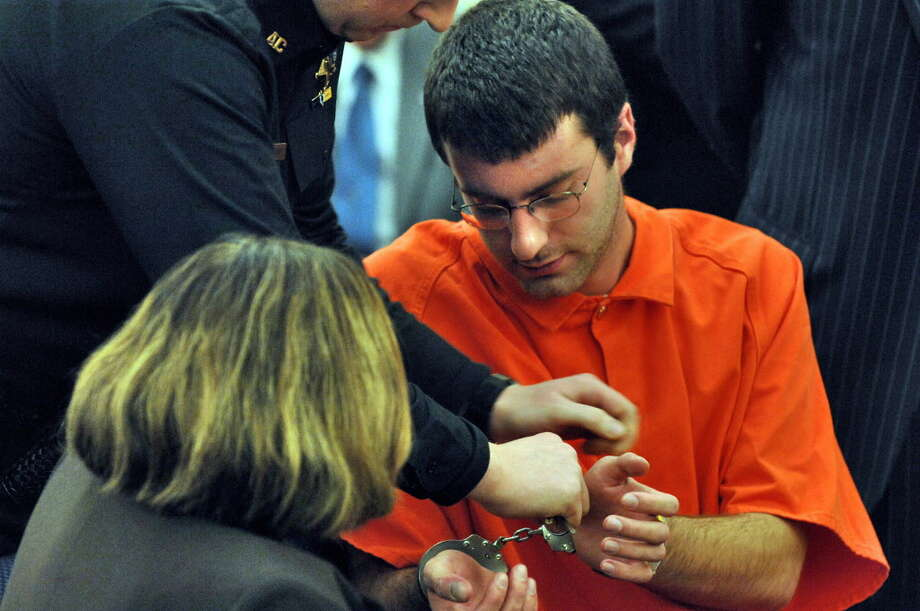 Albany County Sheriff's deputies remove handcuffs on Dec. 12, 2006, from Christopher Porco before the start of a hearing at which he was sentenced to two consecutive terms of 25 years to life for the axe murder of his father, Peter, and the attack on his mother, Joan, in November 2004. (Philip Kamrass/Times Union archive) Photo: PHILIP KAMRASS / ALBANY TIMES UNION