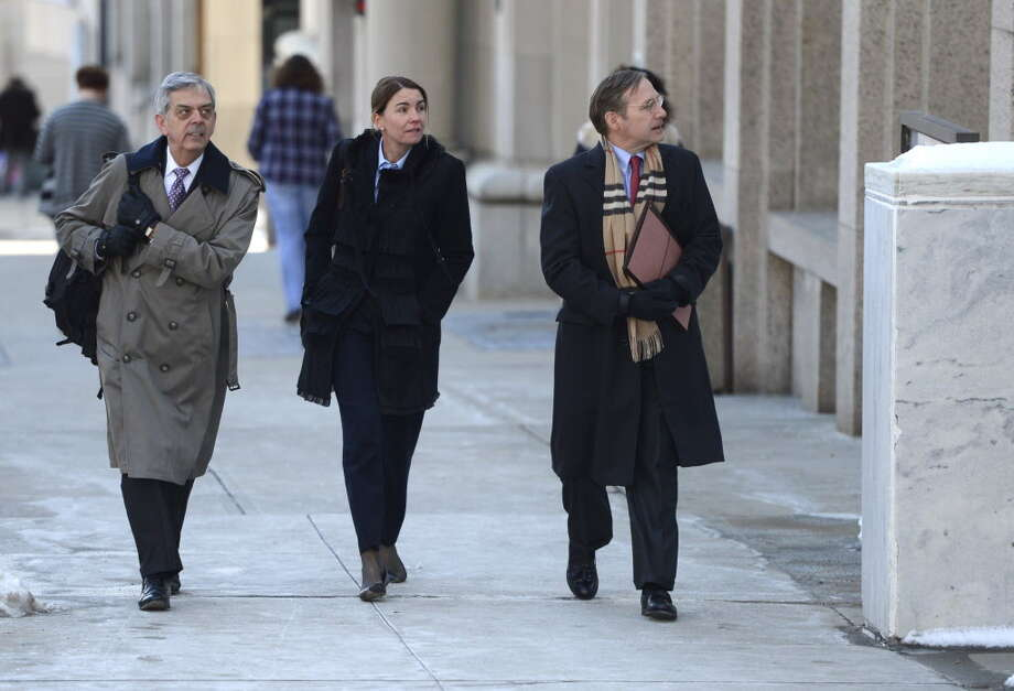From left, attorneys David Shulz; Darci Bailey vice president  and associate general council for the Lifetime Network; and  attorney Michael J. Grygiel enter the Justice Building March 21, 2013, to appear in front of  Appellate Division Justice Elizabeth Garry regarding the airing of the film-for-television on Christopher Porco in Albany, N.Y. (Skip Dickstein/Times Union archive) Photo: SKIP DICKSTEIN