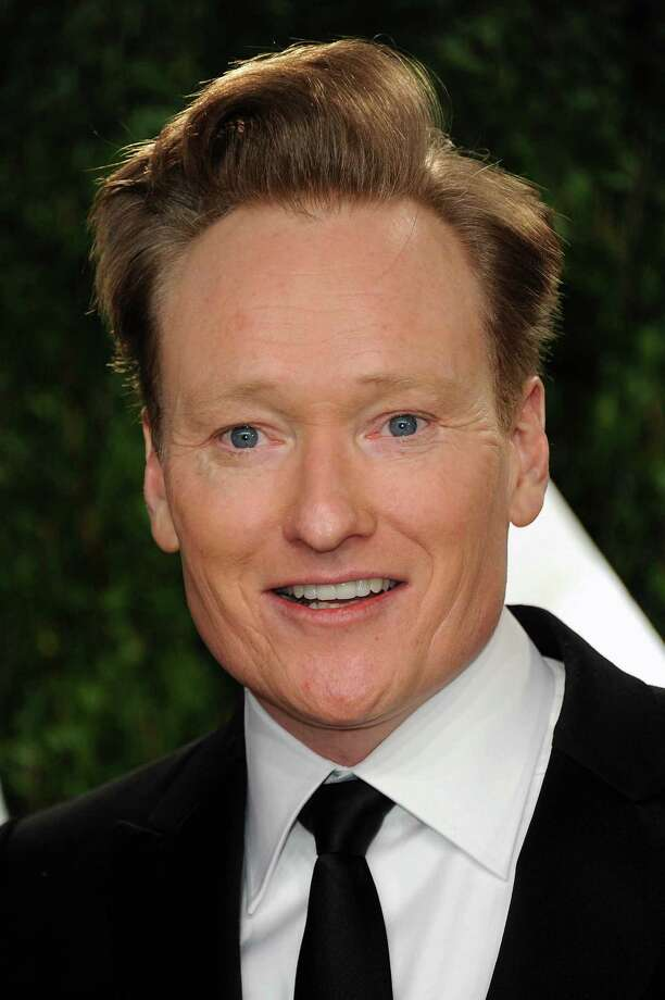 Comedian Conan O'Brien arrives at the 2013 Vanity Fair Oscars Viewing and After Party on Sunday, Feb. 24 2013 at the Sunset Plaza Hotel in West Hollywood, Calif. (Photo by Jordan Strauss/Invision/AP) Photo: Jordan Strauss / Invision