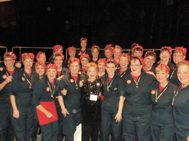 """Saratoga Soundtrack Chorus placed first in Division A (small chorus-containing 15 to 30 singing members) and won fourth place overall in the Greater New York/New Jersey Region 15 Sweet Adelines International Competition on April 12. The chorus took on the persona of """"Rosie the Riveter."""" For their performance they wore navy blue coveralls and red polka-dotted bandanas. Numbers included """"White Cliffs of Dover? under Nancy Faddegon?s direction. (Submitted photo)"""