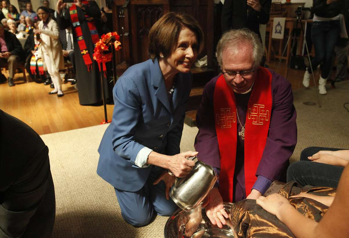 House Democratic Leader Nancy Pelosi, left, prepares to pour water on the feet of Yamile Cruz, 10, left, with the help of Bishop Marc Andrus, right, April 17, 2014 during a public foot-washing ritual honoring immigrants in the Mission at St. John Evangelist Episcopalian Church in San Francisco, Calif. Elected San Francisco officials including House Democratic Leader Nancy Pelosi joined together to take part in the ritual of foot-washing featuring immigrants and people in the community.