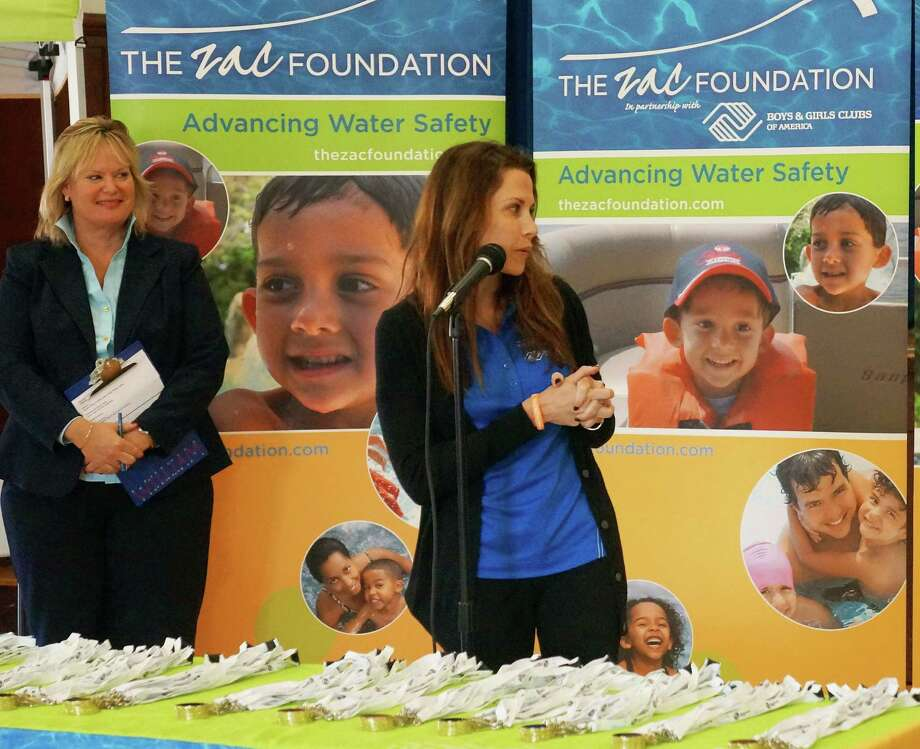 ZAC Foundation co-founder Karen Cohn, right, speaks Thursday at the closing ceremony of the ZAC Camp (at left is Sukie McFadden, interim executive director of the Boys & Girls Club). Photo: Paul Schott, Anne Semmes / Greenwich Time