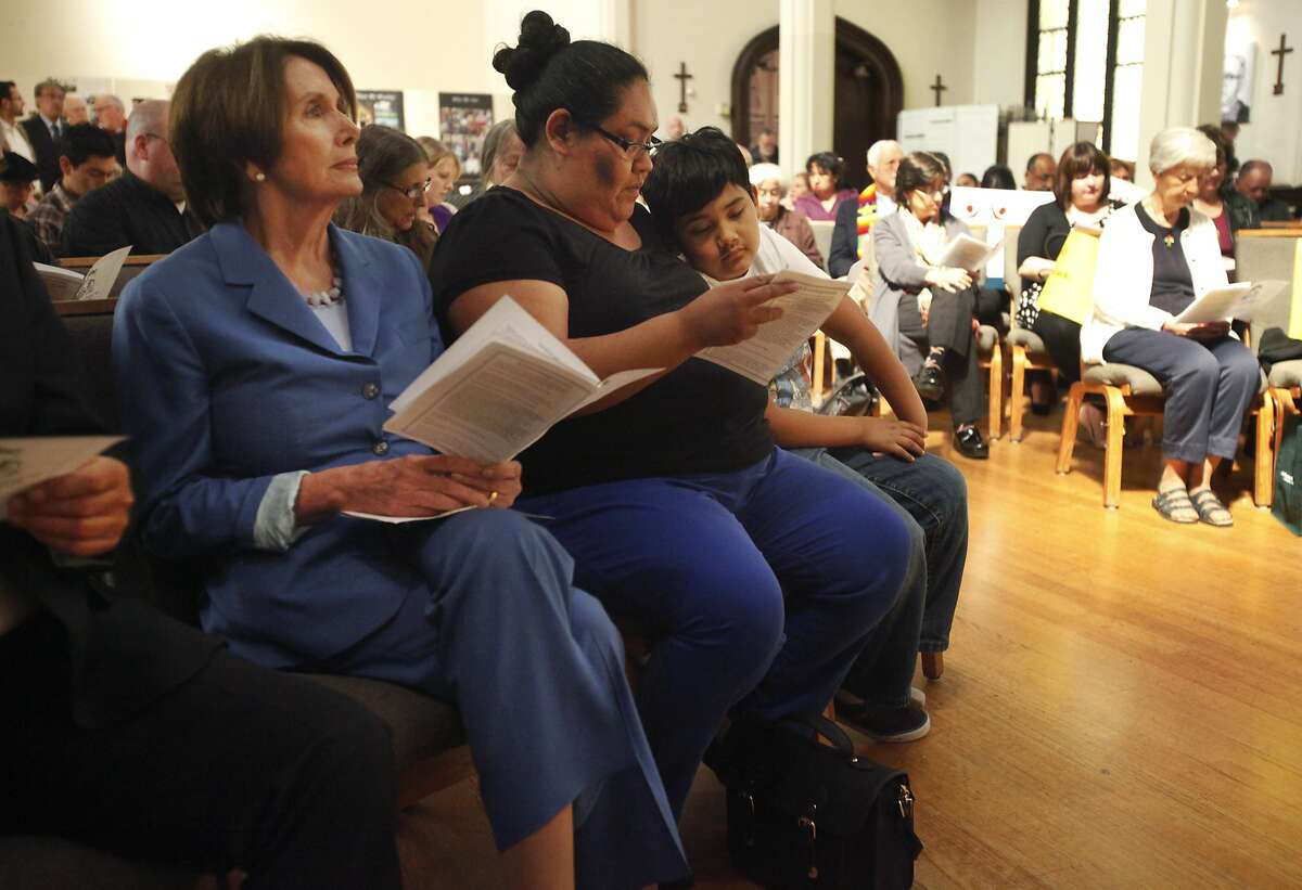 House Democratic Leader Nancy Pelosi, left, sits next to Olga Miranda and her son Joaquin Rubio,8, April 17, 2014 during a public foot-washing ritual honoring immigrants in the Mission at St. John Evangelist Episcopalian Church in San Francisco, Calif. Elected San Francisco officials including House Democratic Leader Nancy Pelosi joined together to take part in the ritual of foot-washing featuring immigrants and people in the community.