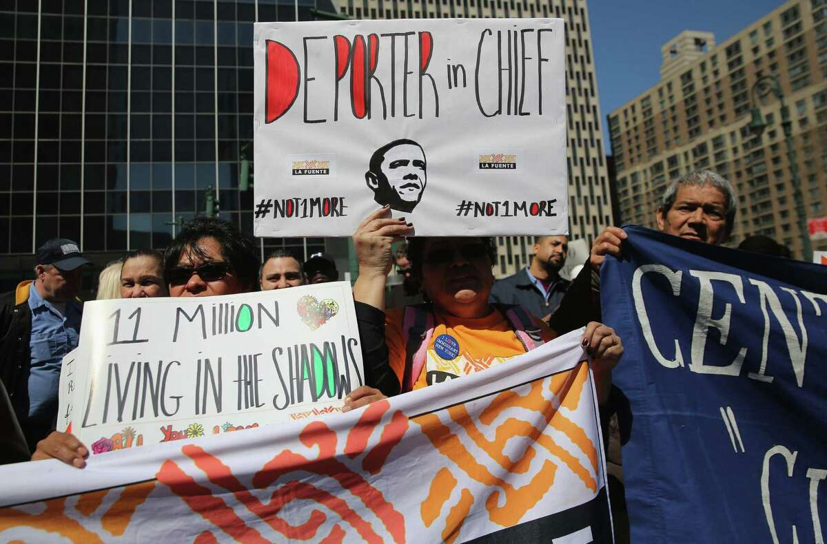 """Immigrant rights activisits demonstrate during a """"National Day of Action"""" April 10 in New York City. They pressed for immigration reform and for the Obama administration to stop its mass deportations."""