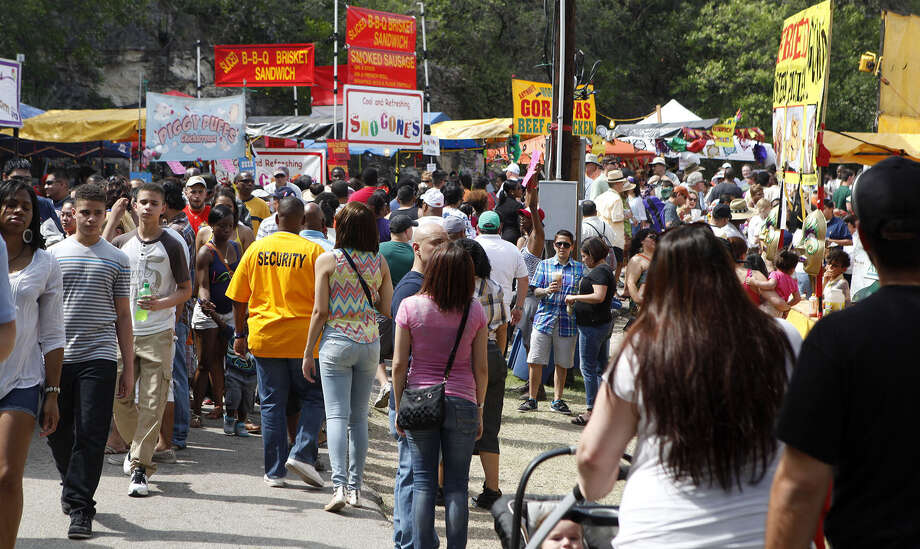 Crowds of celebrants swarm the Sunken Garden Theater during the 29th Annual Taste of New Orleans. Readers criticize the decision to expand Fiesta this year. Photo: Cynthia Esparza / For The Express-News / For the San Antonio Express-News