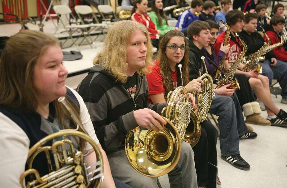 French horn players, left to right, senior Cady Michaels, of Berlin, senior Joe Busse of Bethel and freshman Tori Prokop of Berlin hang out before a joint band rehearsal at Berlin High School of the Berlin and Bethel bands for a combined concert together. (2/9/10) Photo: Contributed Photo / The News-Times Contributed