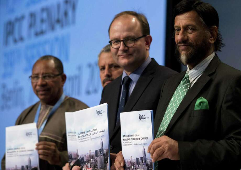 Members of the United Nations' International Panel on Climate Change hold copies of the report that says there's a chance the world can meet the U.N.'s warming limit of 2 degrees Celsius. Photo: John MacDougall / Getty Images / AFP