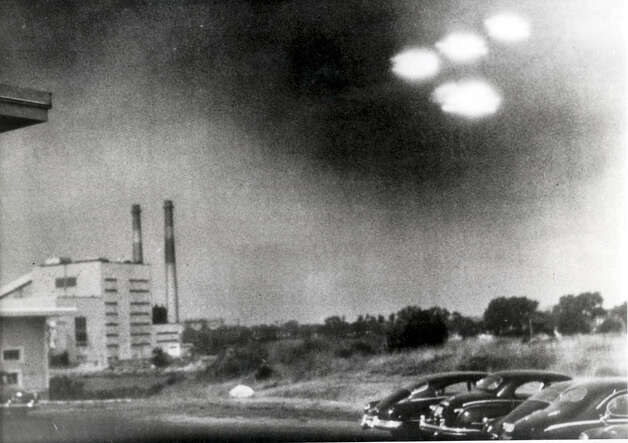 This picture, taken Aug. 3, 1952through the window of a laboratory in Salem, Mass. by a 21 year old member of the U.S. Coastguard, shows four unidentified flying objects as bright lights in the sky, Many American's believe them to be flying saucers Photo: Popperfoto, Popperfoto/Getty Images / Popperfoto