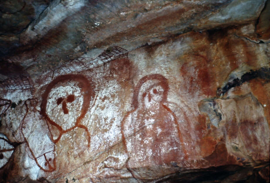 Aboriginal cave painting of a Wandjina, The Wandjina are a group of ancestral beings from the sea and sky that bring rain and control the fertility of the animals and the land. They are depicted in bark painting and rock art throughout the Kimberley region. Australia. Aboriginal. Raft Point, Kimberley Coast. (Photo by Werner Forman/Universal Images Group/Getty Images) Photo: Werner Forman, UIG Via Getty Images / Universal Images Group Editorial