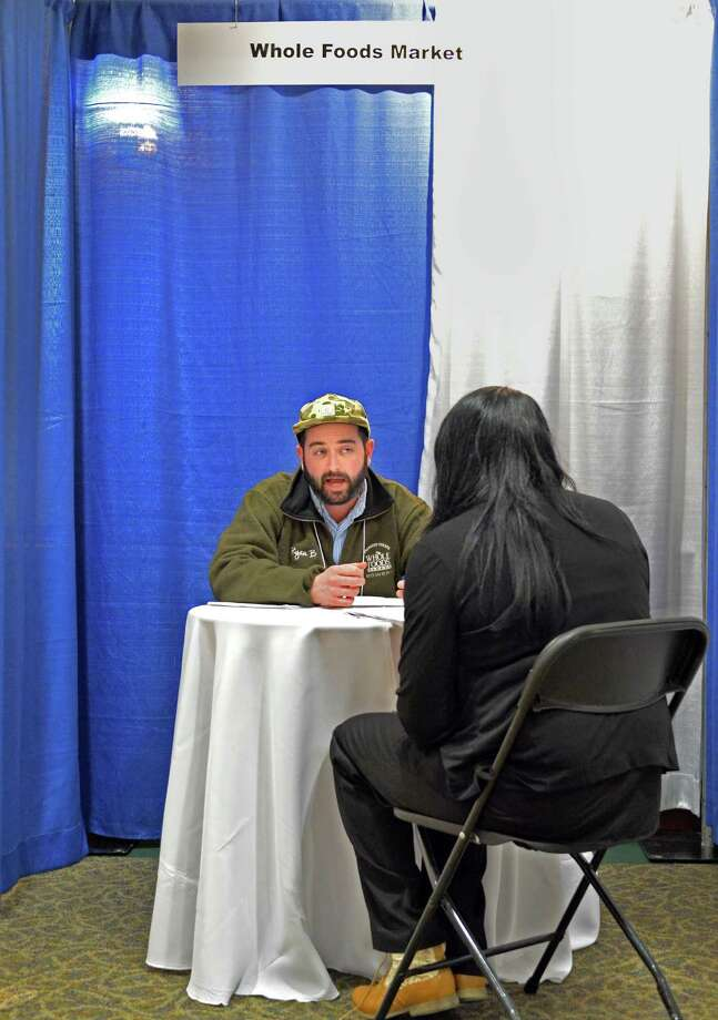 Whole Foods regional chef Ryan Bakst, left, interviews Shadeema Jenkins of Albany during the Martin Luther King Job Fair Thursday April 17, 2014, at Empire State Plaza Convention Center in Albany, N.Y.  (John Carl D'Annibale / Times Union) Photo: John Carl D'Annibale / 00026509A
