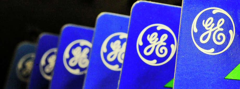 FILE - This file photo made April 11, 2008, shows General Electric Co. logo on products in Danvers, Mass. General Electric is reporting lower net income Thursday April 17, 2014  than a year ago because last year's results included the sale of NBC Universal.  (AP Photo/Lisa Poole, File) ORG XMIT: NY112 Photo: Lisa Poole / AP