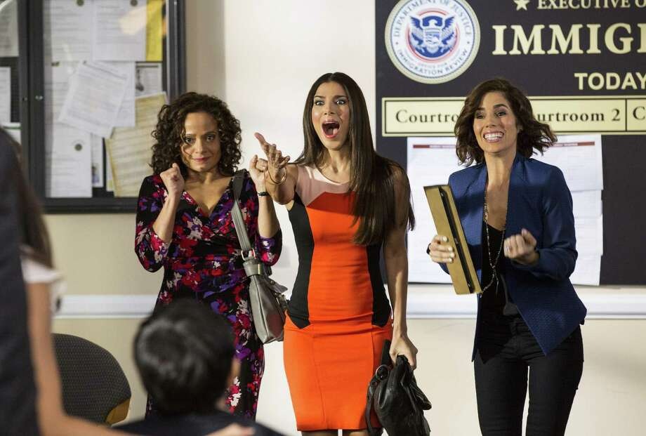 "Three of Lifetime's ""Devious Maids"" (Judy Reyes, Roselyn Sanchez and Ana Ortiz) respond to happy news in the second season premiere of the sudsy cable hit. The episode was directed by Eva Longoria. Photo: Lifetime / Copyright 2012 Bob Mahoney"