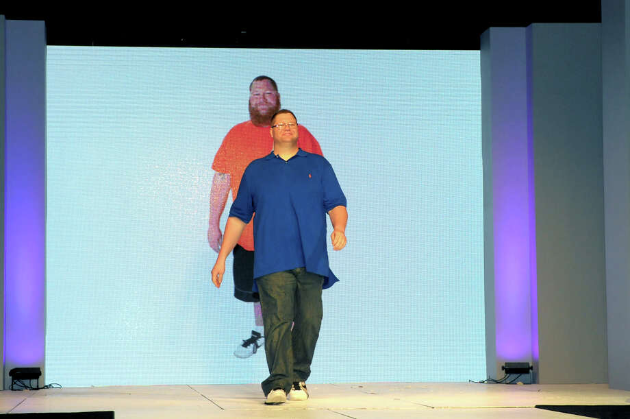 """Richard Arrington of Aransas Pass was one of the two """"health hero"""" winners of the 2014 H-E-B Slim Down Showdown. Arrington showed off his new body at the competition's grand finale at the Convention Center on Saturday, April 12, 2014. Photo: COURTESY, COURTESY THE DEBERRY GROUP"""