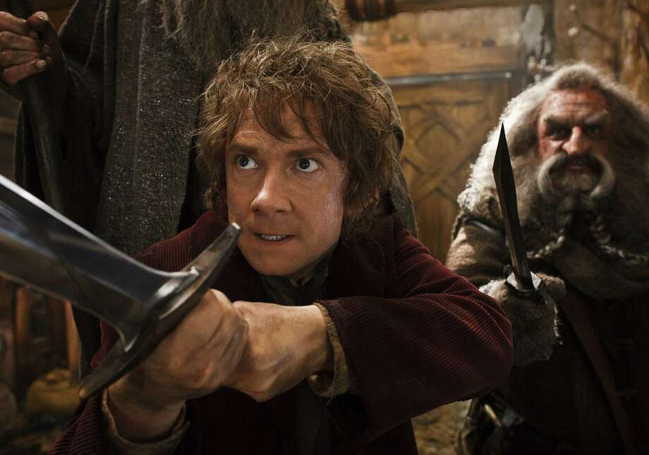 "Martin Freeman (left) and John Callen get defensive in a scene from ""The Hobbit: The Desolation of Smaug."" Photo: Warner Bros. / Warner Bros. Pictures"