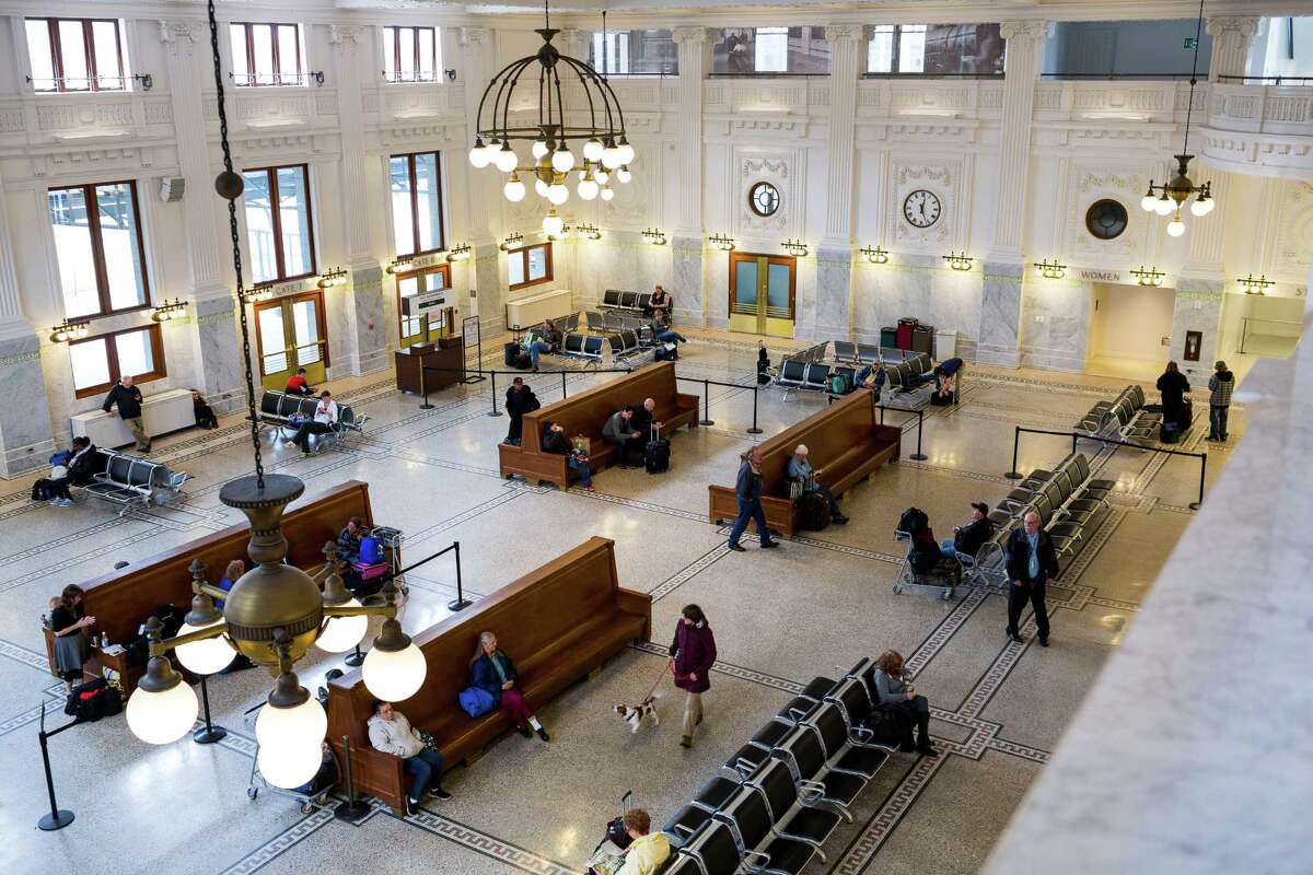 Seattle's historic train depot became a sad, dingy place over the years. But after undergoing a $55-million revitalization project, it debuted this gorgeous, two-story waiting room, with restored wainscoting, chandeliers and ornamental garland motifs in 2013. King Street is pictured on April 17, 2014, a year after its grand re-opening.