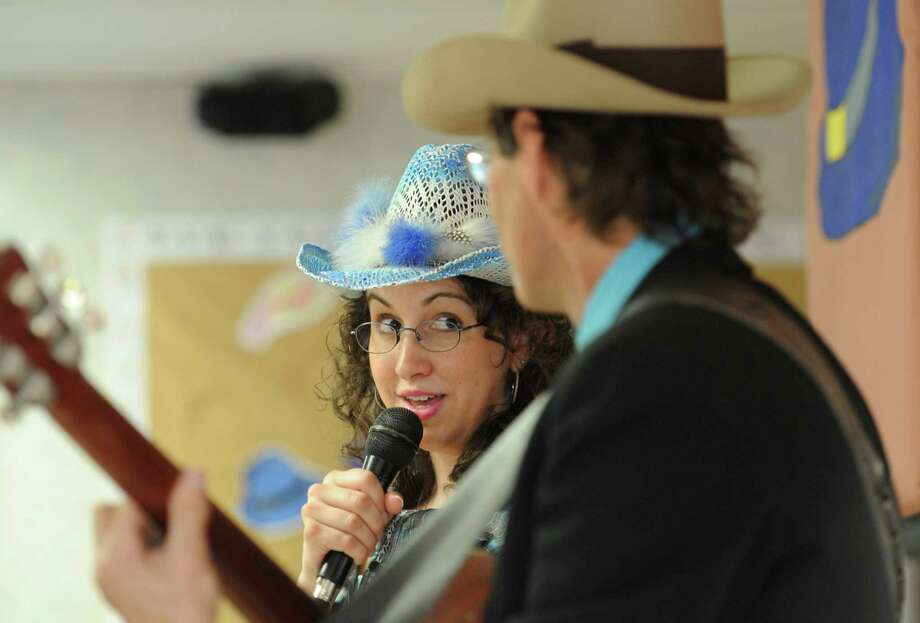 Pamela Shepperd and Billy Michael perform a song during the Hat Day Celebration at the Filosa Hancock Hall in Danbury, Conn. Thursday, April 17, 2014.  Photo: Tyler Sizemore / The News-Times