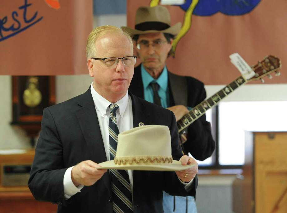 Danbury Mayor Mark Boughton shows his hat at the Hat Day Celebration at the Filosa Hancock Hall in Danbury, Conn. Thursday, April 17, 2014. Boughton stopped by the event to chat about Danbury's history of hatting. Photo: Tyler Sizemore / The News-Times