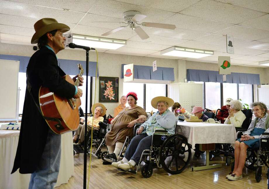 Bethel musician Billy Michael performs a song during the Hat Day Celebration at the Filosa Hancock Hall in Danbury, Conn. Thursday, April 17, 2014.  Photo: Tyler Sizemore / The News-Times