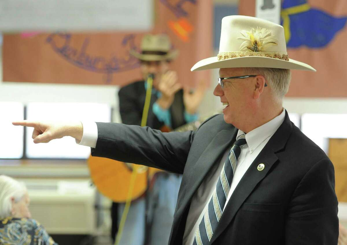 Danbury Mayor Mark Boughton wears a hat at the Hat Day Celebration at the Filosa Hancock Hall in Danbury, Conn. Thursday, April 17, 2014. Boughton stopped by the event to chat about Danbury's history of hatting.