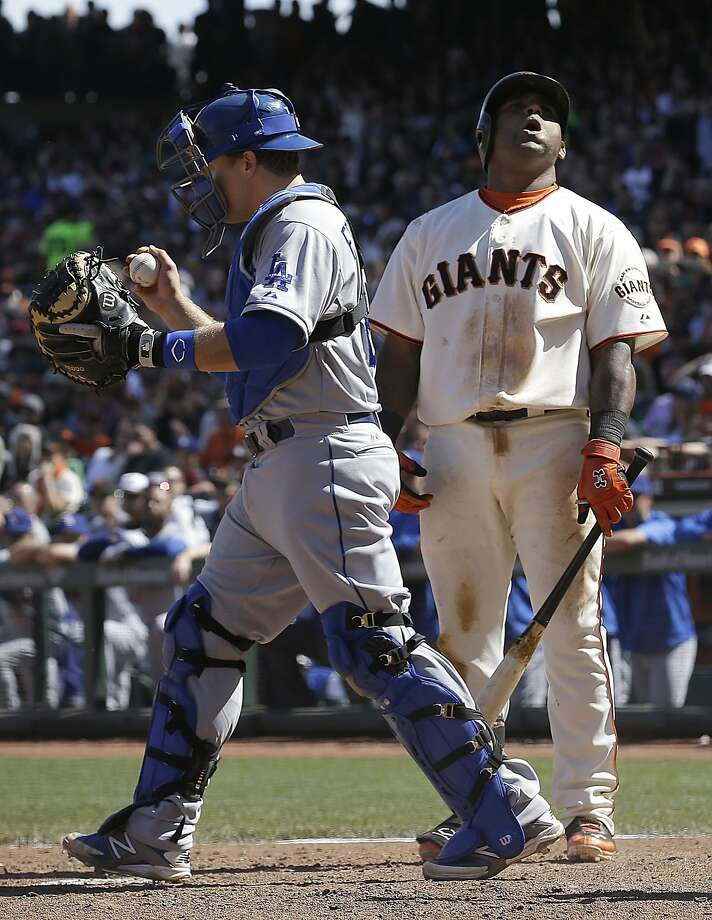 Pablo Sandoval is left wanting in the eighth inning after being struck out by Brian Wilson with two on. Photo: Jeff Chiu, Associated Press