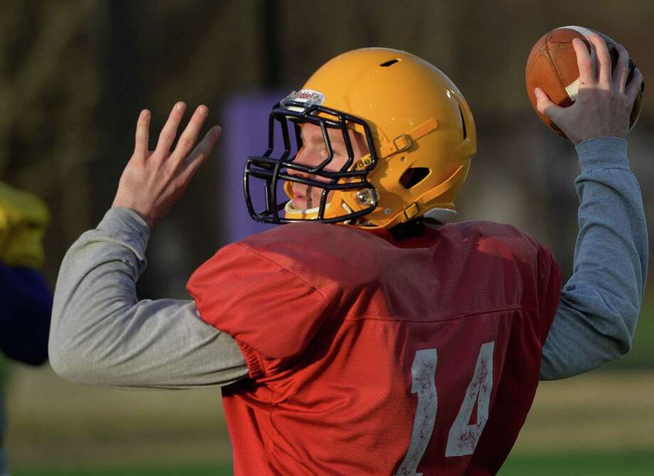 University at Albany quarterback Will Fiacchi winds up to make a throw during spring practice Thursday morning, April 17, 2014, on Bob Ford Field at UAlbany in Albany, N.Y. (Skip Dickstein / Times Union) Photo: SKIP DICKSTEIN / 00026504A