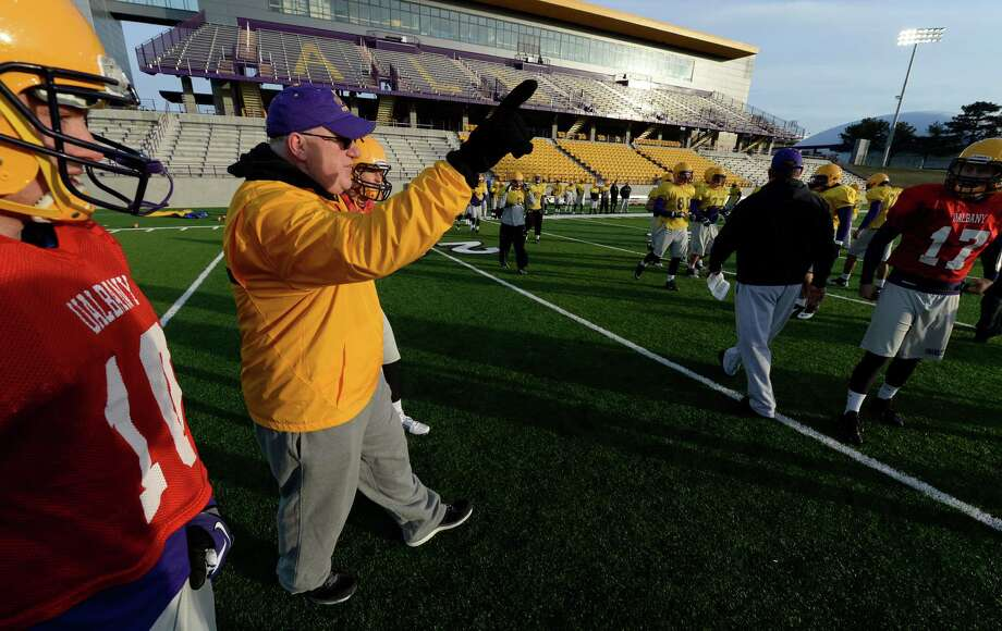 University at Albany's new head football coach Greg Gattuso gives instruction during a spring practice session Thursday morning, April 17, 2014, on Bob Ford Field at UAlbany in Albany, N.Y. (Skip Dickstein / Times Union) Photo: SKIP DICKSTEIN / 00026504A
