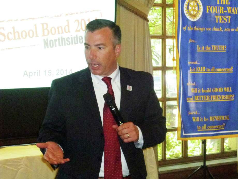 Dr. Brian Woods, superintendent of the Northside Independent School District, makes a presentation on the proposed $648.34 million 2014 school bond to the Dominion Rotary Club April 15, 2014.  The bond election is May 10, 2014. Photo: Joni Simon / For The Helotes Wee