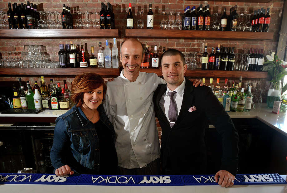 Trattoria 'A Vucchella is a new Italian restaurant on Fairfield Avenue in downtown Bridgeport, Conn. on Thursday April 17, 2014. From left to right is owner Jennifer Galletti, chef/owner Pasquale De Martino, and principal Thomas Bepko. Photo: Christian Abraham / Connecticut Post