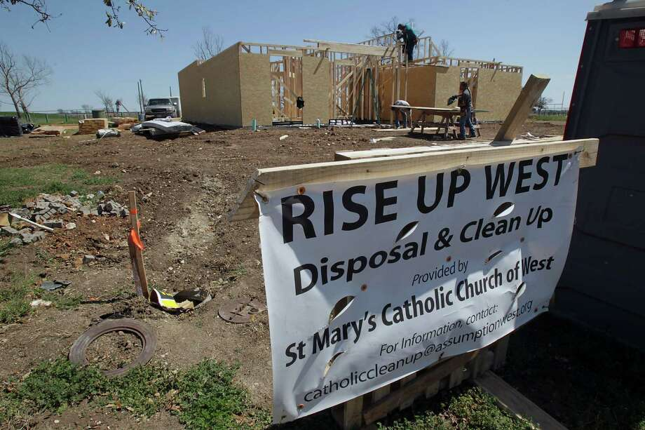 "A sign that says ""Rise Up West"" is staked in front of homes being rebuilt in the year since the April 17, 2013, fertilizer plant blast. Photo: James Nielsen, Staff / © 2014  Houston Chronicle"
