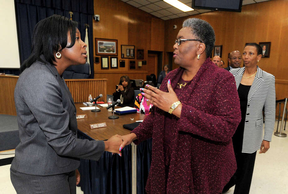 Ann Westbrooks was named Tuesday as the Beaumont Independent School District's new CFO/Comptroller. Westbrooks, left, is greater by the board after the announcement.  Photo taken Tuesday, April 08, 2014 Guiseppe Barranco/@spotnewsshooter Photo: Guiseppe Barranco, Photo Editor