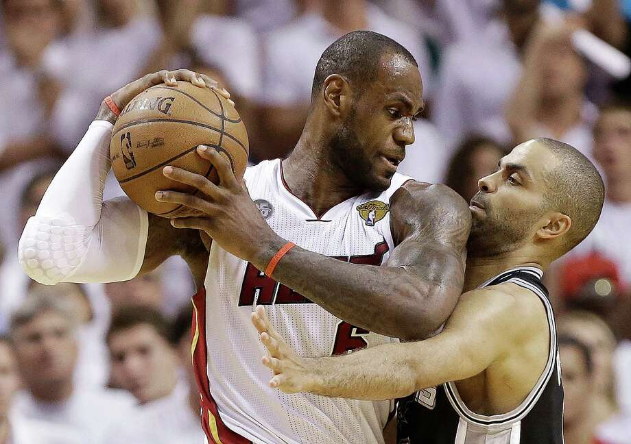 FILE - In this June 18, 2013 file photo, San Antonio Spurs point guard Tony Parker, right, and Miami Heat small forward LeBron James collide during the second half of Game 6 of the NBA Finals in Miami.  A rematch of last year's thrilling NBA Finals finish is possible, but the Spurs and Heat would have to get through tough paths to get there.  (AP Photo/Lynne Sladky, File) ORG XMIT: NY152 Photo: Lynne Sladky / AP