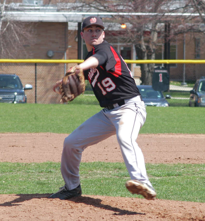 Fairfield Warde pitcher Nick Nardone threw two innings of relief, allowing one run, to help the Mustangs preserve a 7-5 win over Darien on Thursday, April 17 in an FCIAC baseball game in Fairfield. Photo: Andy Hutchison / Fairfield Citizen