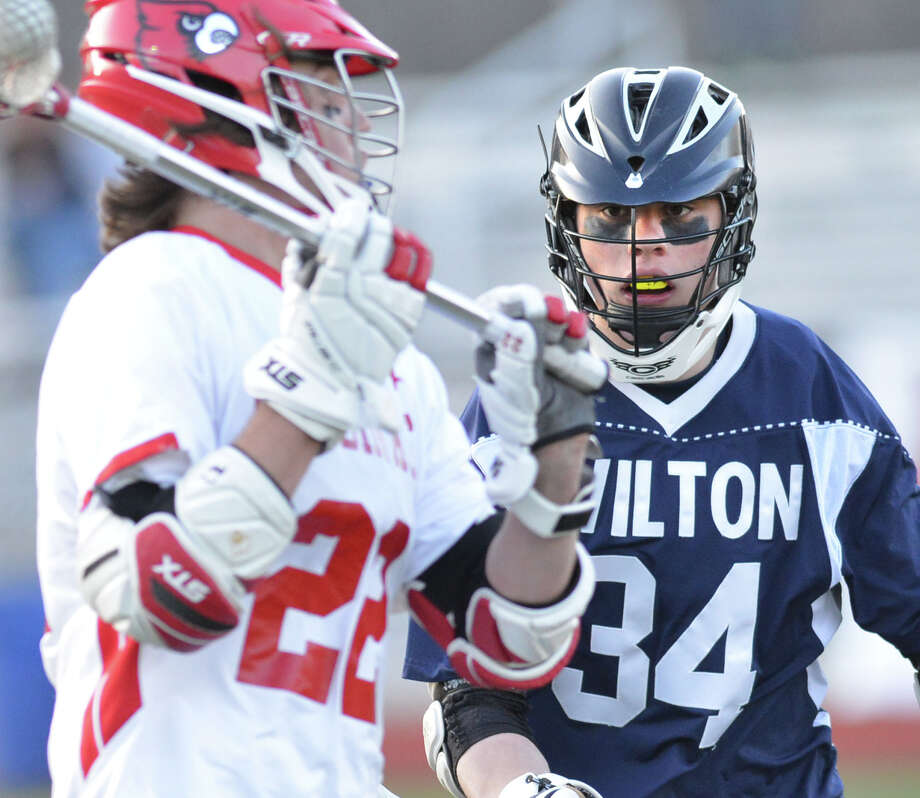 Boys high school lacrosse match between Greenwich High School and Wilton High School at Greenwich, Thursday night, April 17, 2014. Greenwich defeated Wilton,18-7. Photo: Bob Luckey / Greenwich Time