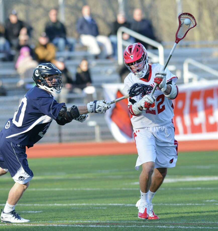 Ryan Flippin (#22) of Greenwich shoots during the high school lacrosse match between Greenwich High School and Wilton High School at Greenwich, Thursday night, April 17, 2014. Greenwich defeated Wilton,18-7. Photo: Bob Luckey / Greenwich Time