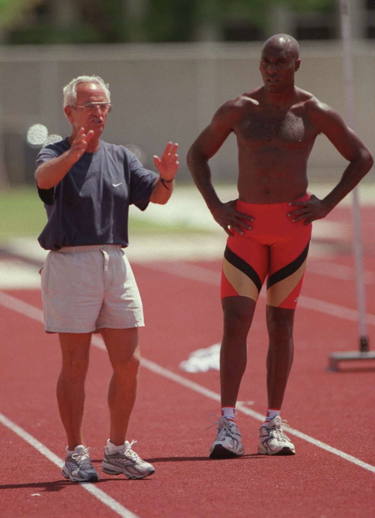 Tom Tellez, left, coaches Frank Rutherford, an Olympic Triple Jump Bronze Medalist, Frank Rutherford at the Carl Lewis Track Complex on the University of Houston campus Tuesday July 11, 2000. HOUCHRON CAPTION (07/12/2000): Meanwhile, at the same complex, Tellez offers some instruction to Frank Rutherford, an Olympic bronze medalist in the triple jump who is trying to qualify to represent the Bahamas again in the Summer Games.