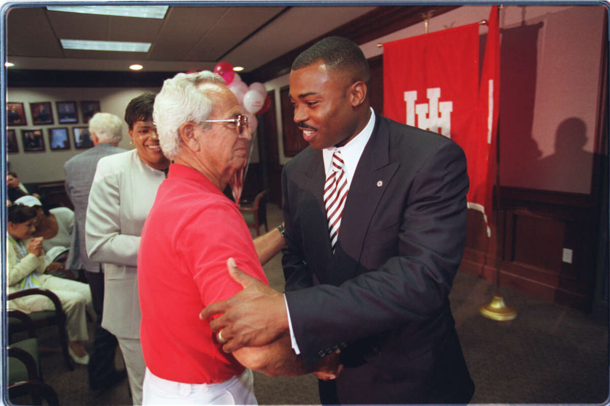 HOUCHRON CAPTION (06/18/1998): Longtime University of Houston track and field coach Tom Tellez, left, who announced his retirement recently, gives a warm welcome to former Cougars athlete Leroy Burrell, who was introduced as Tellez's successor Wednesday. HOUCHRON CAPTION (09/11/1998): Time goes by so fast, I figure I have only a couple more years to say, I'm Leroy Burrell, and People will remember. UH track coach Leroy Burrell, who broke the 100-meter world record in 1984. HOUCHRON CAPTION (02/25/2001): Burrell. HOUCHRON CAPTION (11/09/2002): LEROY BURRELL.
