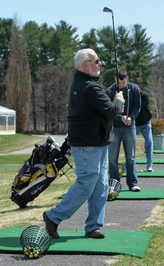 Mike McCarthy hits off the tee on the driving range at Capital Hills at Capital Hills at Albany municipal golf course Thursday afternoon April 17, 2014, in Albany, N.Y. The course opened for the season on Thursday. (Skip Dickstein / Times Union) Photo: SKIP DICKSTEIN