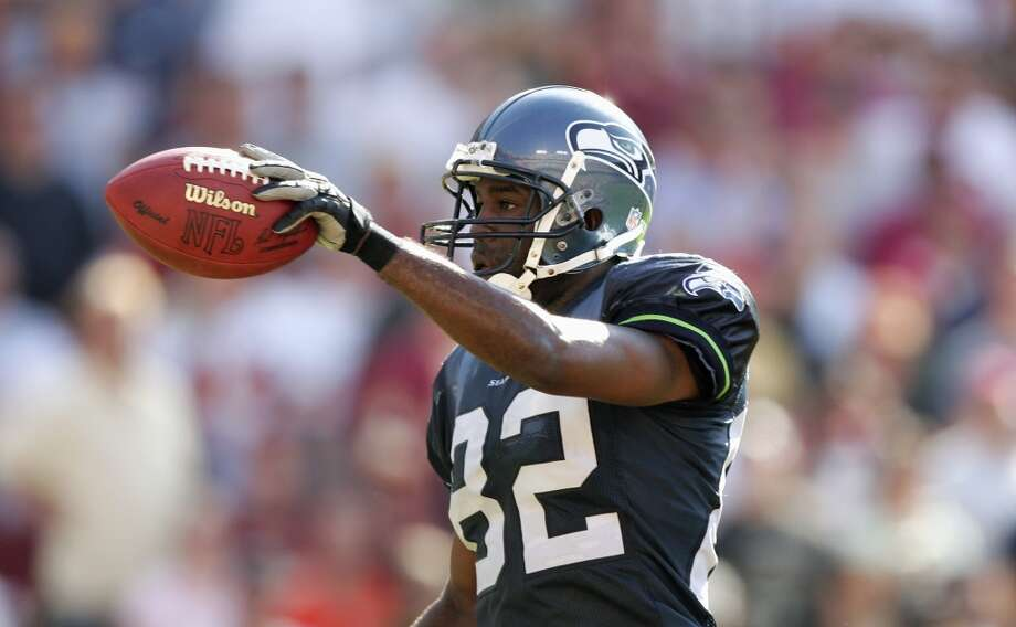 Darrell Jackson#82, 2000-2006  Jackson had three 1,000-yard seasons with the Seahawks and finished his time in Seattle with a 10-touchdown year in 2006. He held the single-season Seattle franchise record for receptions with 87 in 2004 before Bobby Engram broke it in 2007. In Super Bowl XL, it was Jackson whose touchdown catch in the first quarter was reversed due to a controversial pass-interference penalty. Photo: Al Bello, Getty Images