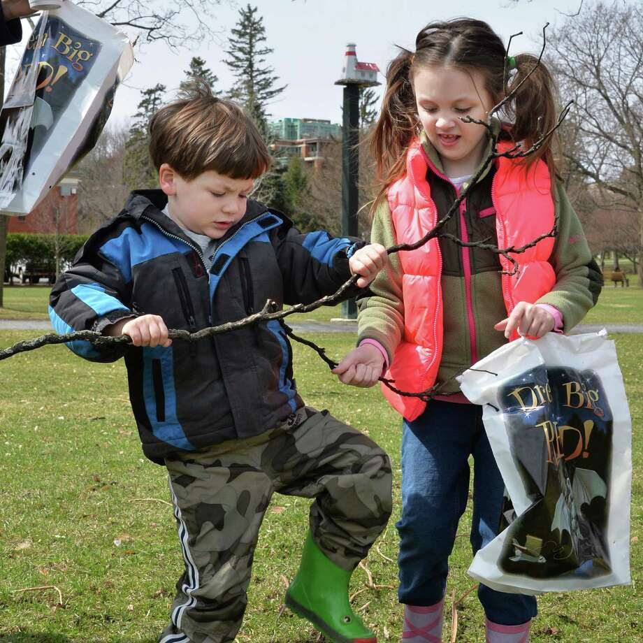 Joey MvGuinness, 4, left, of Wilton breaks a stick to share with his sister Ella, 6, as they collect natural materials in Congress Park to make a twig vase during a Reconnecting with Nature program held by Saratoga Springs Public Library Thursday morning, April 17, 2014, in Saratoga Springs, N.Y.  (John Carl D'Annibale / Times Union) Photo: John Carl D'Annibale / 00026521A