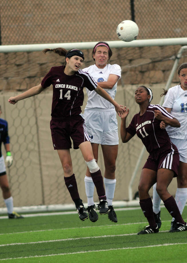 Cinco Ranch junior midfielder Kristen Hutar (#14) battles Lewisville Hebron sophomore midfielder Logan Layn with backup from teammate Halleanne Dure (#11) during their Girls Class 5A state soccer semifinal match at Birkelbach Field in Georgetown on Thursday. Photo: Jerry Baker, For The Chronicle