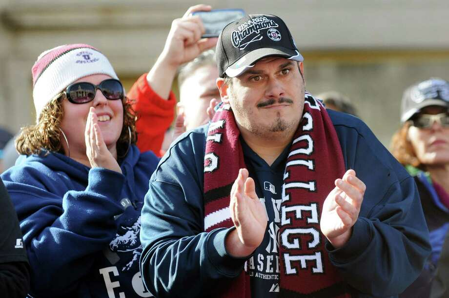 Union fan's Jennifer Cariglio, left, and Mark Goldman, both of Schenectady, applaud the NCAA Hockey Champions during a celebration to mark the team's achievement on Thursday, April 17, 2014, at City Hall in Schenectady, N.Y. (Cindy Schultz / Times Union) Photo: Cindy Schultz / 00026500A