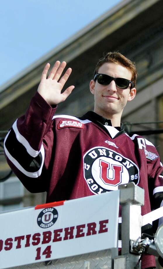 Union's Shayne Gostisbehere waves to fans from a fire truck during a parade to honor the NCAA Hockey Champions  on Thursday, April 17, 2014, in Schenectady, N.Y. (Cindy Schultz / Times Union) Photo: Cindy Schultz / 00026500A