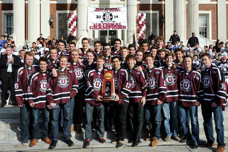 Union's NCAA Hockey Champions pose with their trophy during a celebration on Thursday, April 17, 2014, at City Hall in Schenectady, N.Y. (Cindy Schultz / Times Union) Photo: Cindy Schultz / 00026500A
